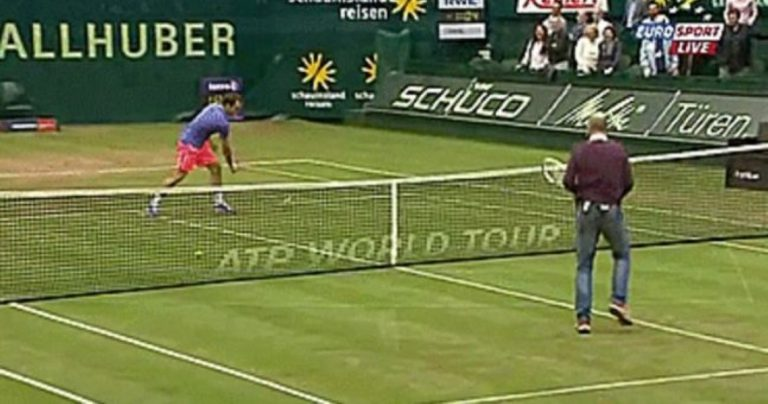 Famous Soccer Manager Schools Roger Federer With EPIC Trick Shot!